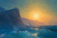 View of a steep, rocky coast and a rough sea at sunset