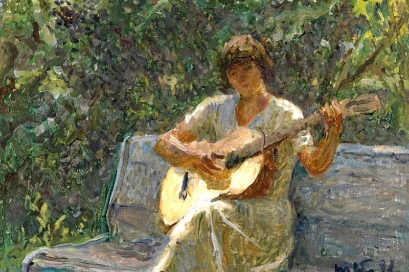Tetyana Yablonska. Granddaughter playing the guitar