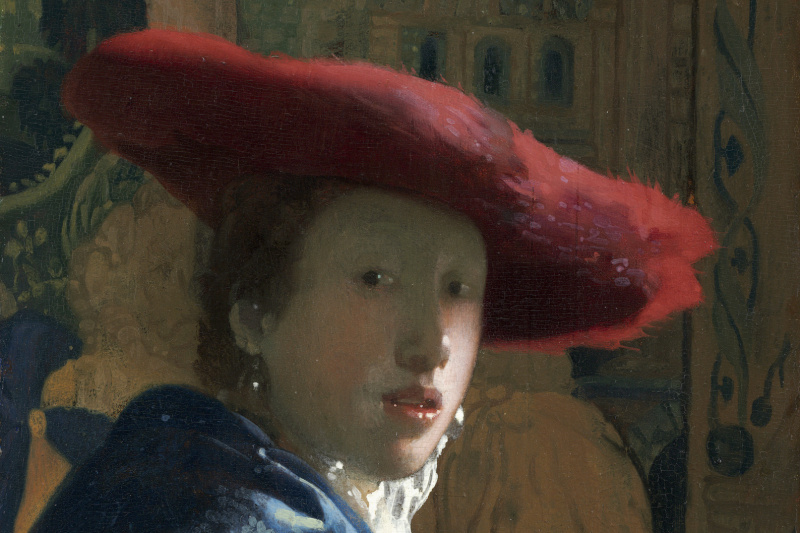 Jan Vermeer. A woman in a red hat