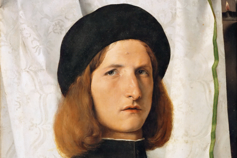 Lorenzo Lotto. Portrait of a Young Man with a Lamp