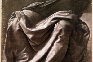 The folds of clothing sitting figure