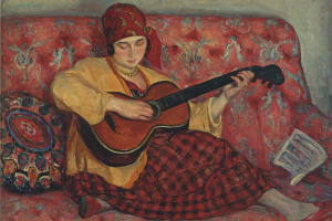 A young girl with a guitar