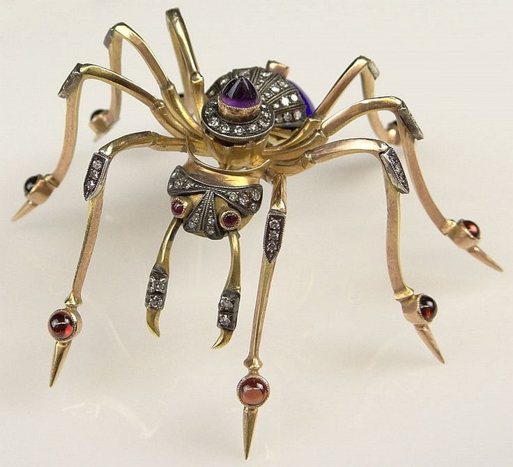 Brooch. Gold, diamonds, amethysts, rubies. Russia, early 20th century.