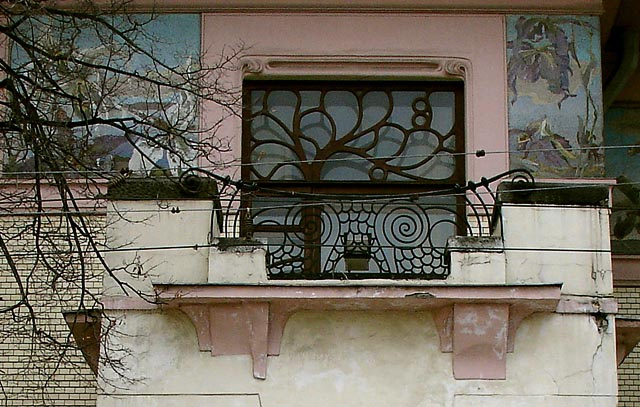 Balcony with spiral owl eyes against the frieze with orchids. Ryabushinsky mansion.