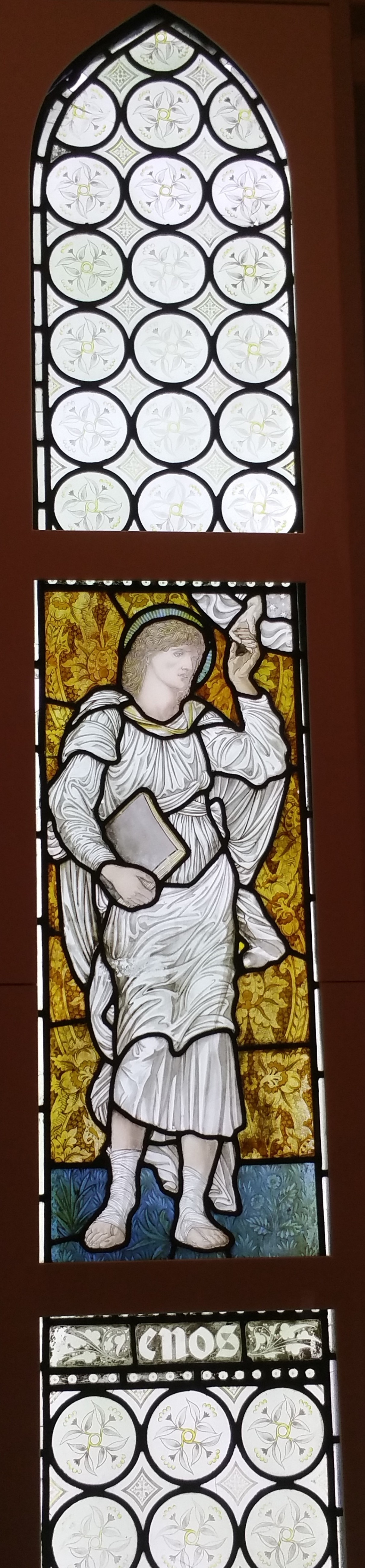 Angel with a book. Stained glass window in the gallery of William Morris in London