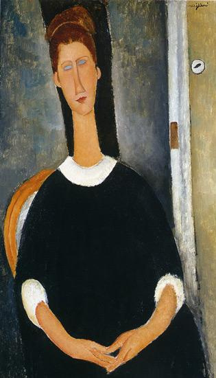 Amedeo Modigliani. Seated portrait of Jeanne hebuterne with entwined fingers