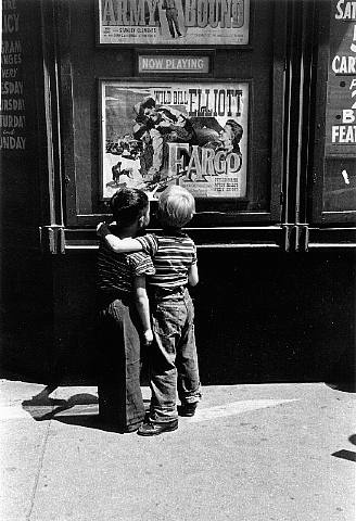 """Historical photos. Boys in front of the poster of the movie """"Fargo"""" (1952) on Second Avenue in New York"""