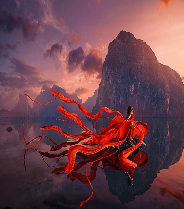 Shabin Mashio. The fusion of a red-dressed girl and the beauty of nature at sunset