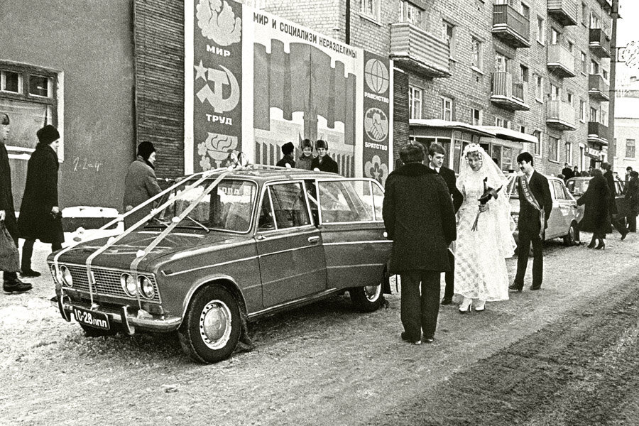 """Historical photos. Wedding on the background of the poster """"Peace and socialism are inseparable"""""""