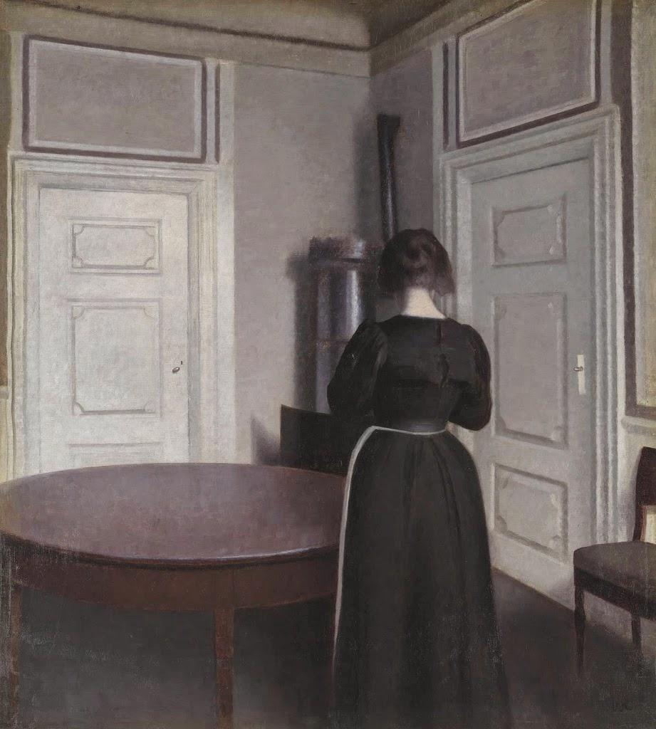 Вильгельм Хаммерсхёй. Интерьер с женщиной у стола
