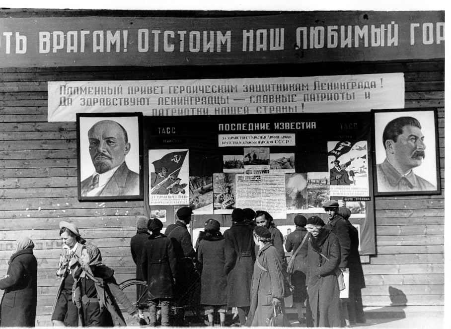 "Historical photos. ""Fiery greetings to the defenders of Leningrad"" and anti-war posters in besieged Leningrad"