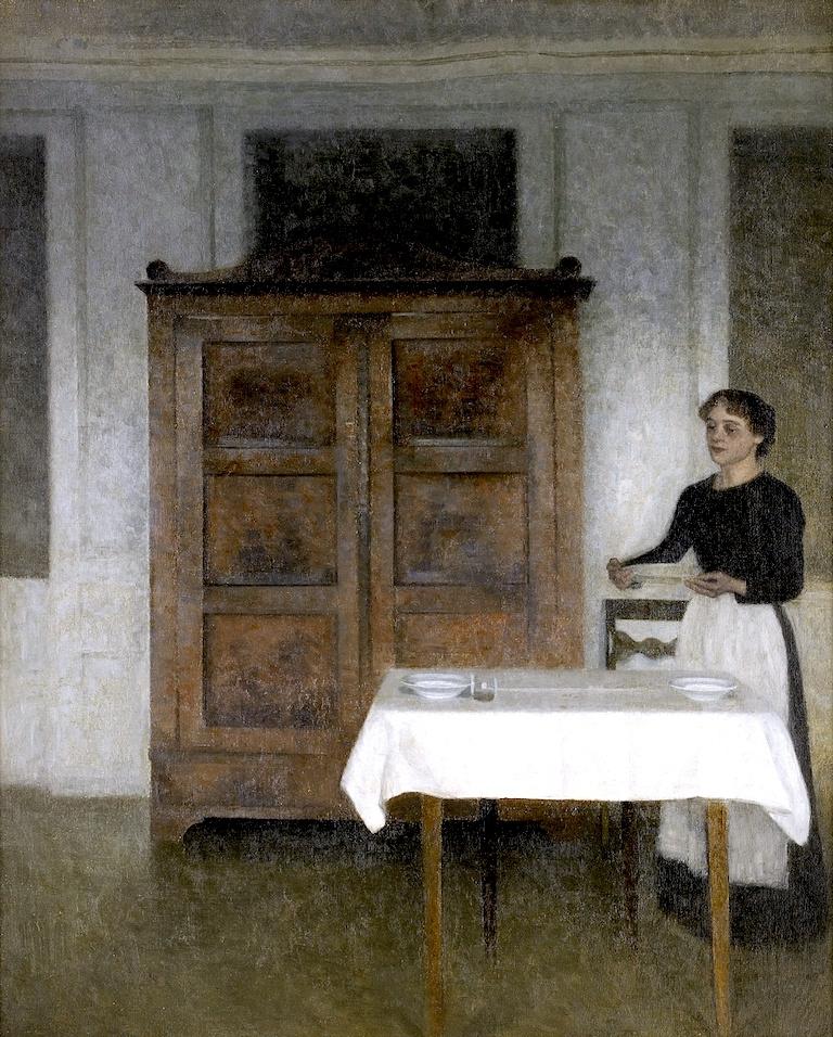 Вильгельм Хаммерсхёй. Интерьер с девушкой, накрывающей стол