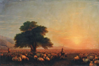 Shepherds with their flock at sunset