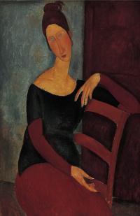 Портрет Жанны Эбютерн, положившей руку на спинку стула