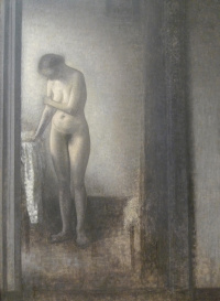 Standing nude model in the interior
