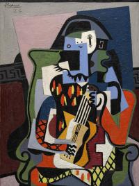 Pablo Picasso. Harlequin musician