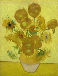 Подсолнухи в желтой вазе
