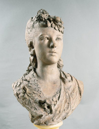 Bust girl with flowers in her hair