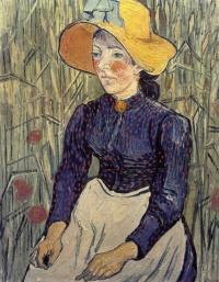 Портрет молодой женщины в соломенной шляпе среди пшеницы