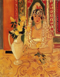 Woman at the table with a vase