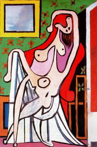 Nude in a red armchair