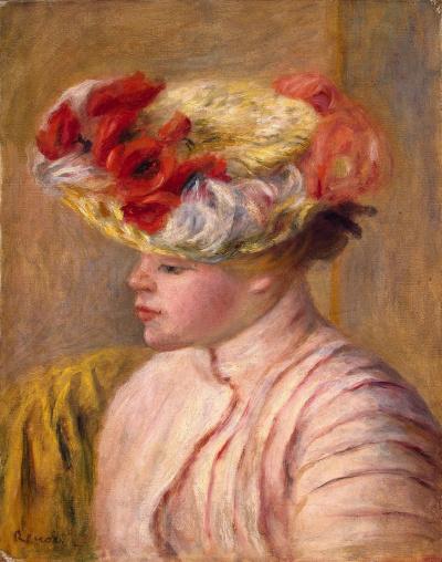 Молодая женщина в шляпе с цветами