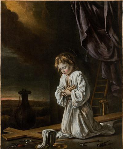 Un Jésus enfant méditant devant une croix