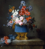 A bouquet of flowers in a blue vase