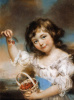 Маленькая девочка, показывающая вишни