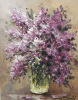 A bouquet of lilac in a glass vase N3