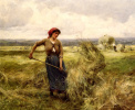 The woman turns hay