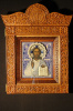 Icon of Christ Pantocrator in a porcelain frame and carved icon case