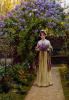 Girl in long dress in the garden