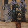 Цветок в горшке и керамический кувшин