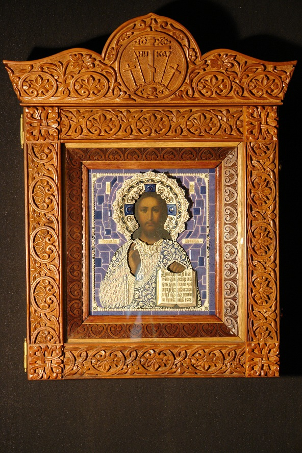 Moscow Icon Painting Workshop. Icon of Christ Pantocrator in a porcelain frame and carved icon case