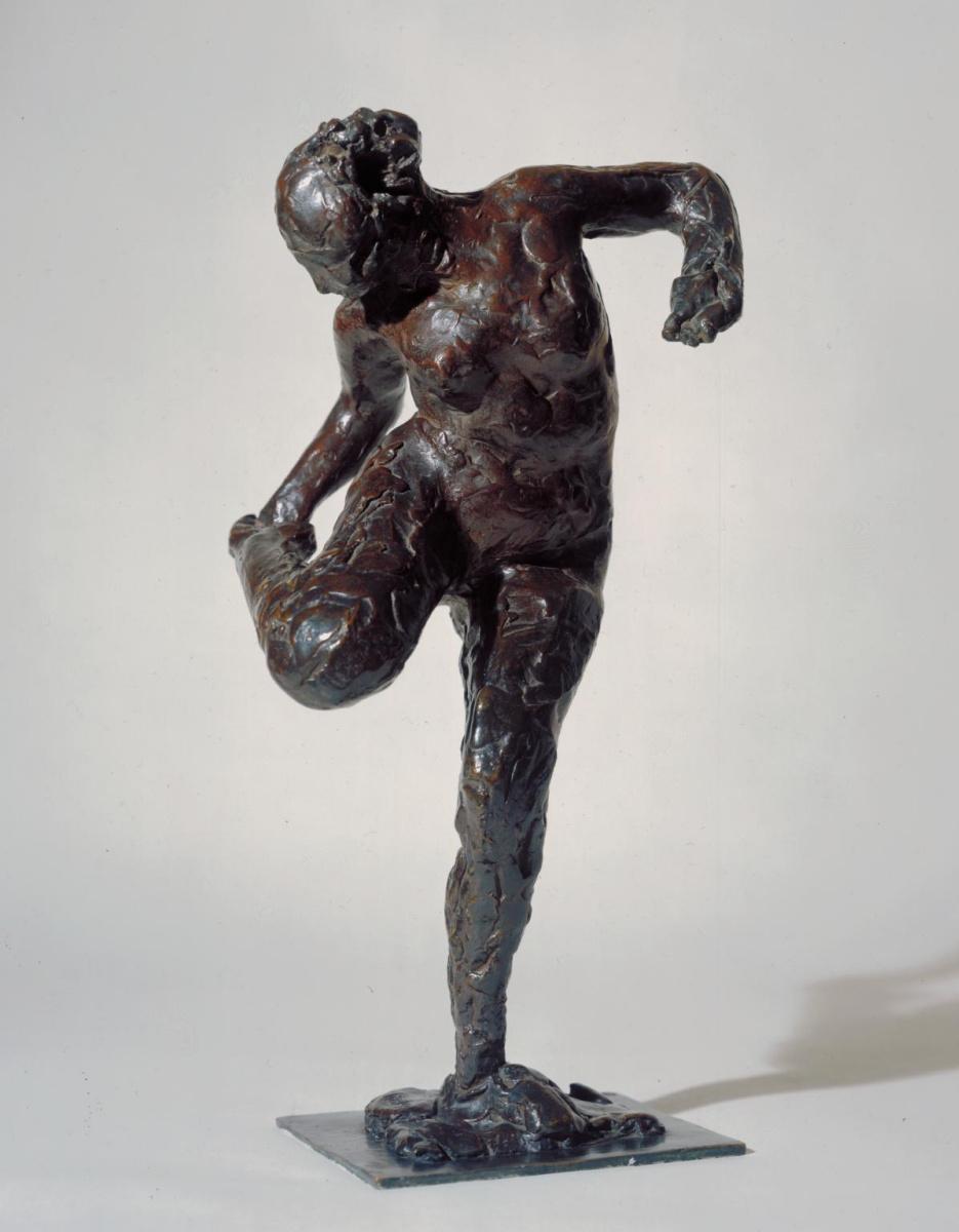 Edgar Degas. The woman, looking at his right foot