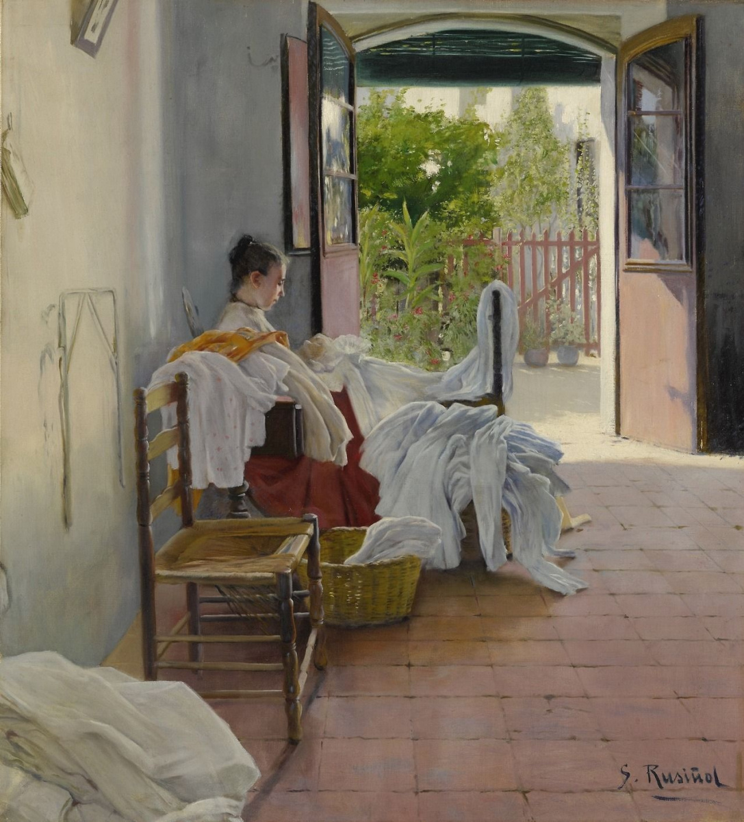 Santiago Rusignol. Interior in Sitges with a Young Woman Sewing