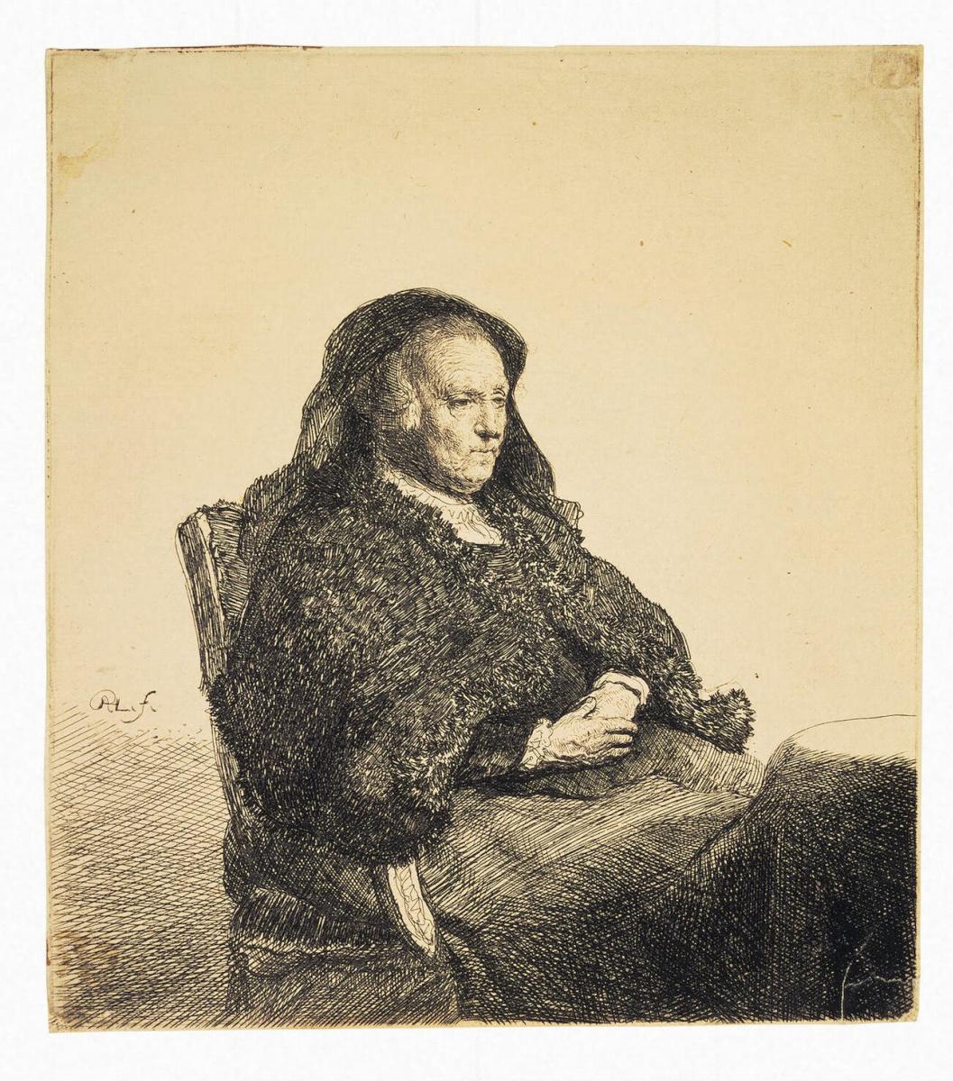 Рембрандт Ван Рейн. Портрет матери Рембрандта, сидящей за столом