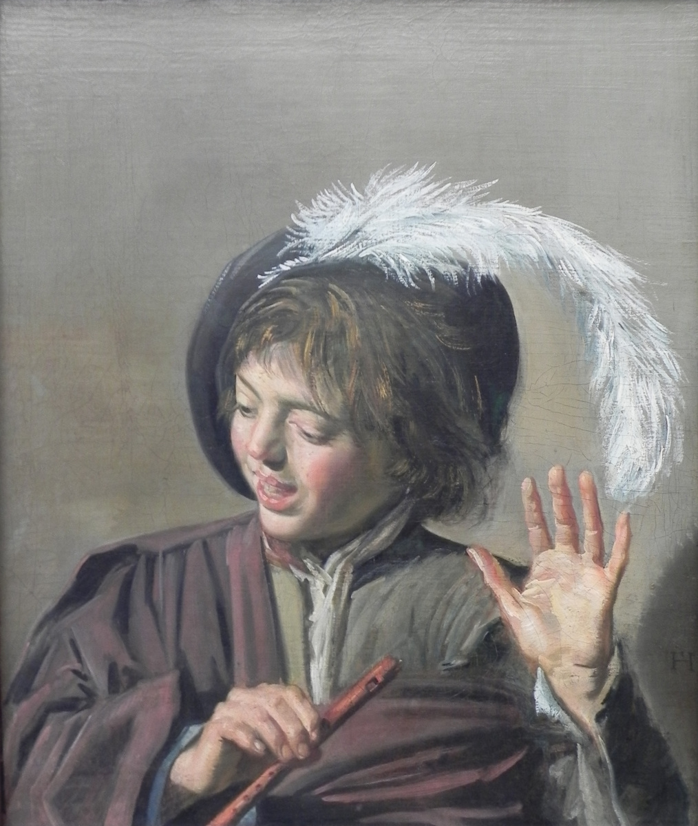 Singing boy with a flute
