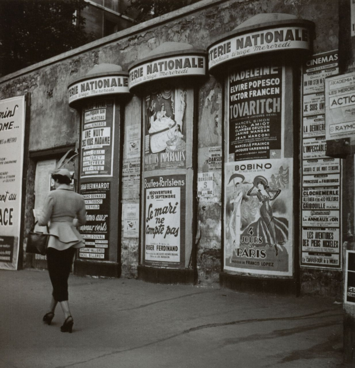 Historical photos. Elegant lady. Paris 1950s