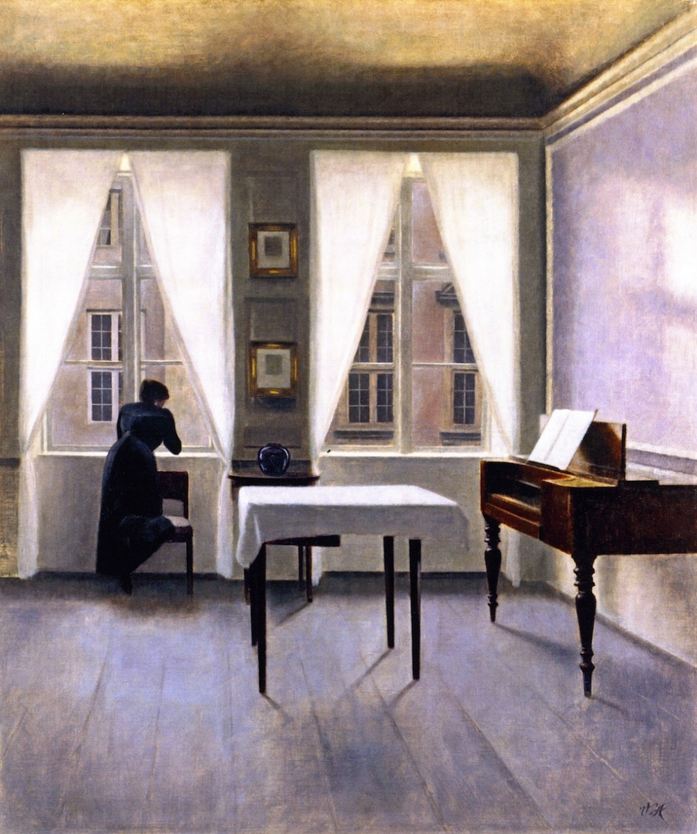 Vilhelm Hammershøi. Interior with a woman at the window, leaning on a chair. Strandgedd 30