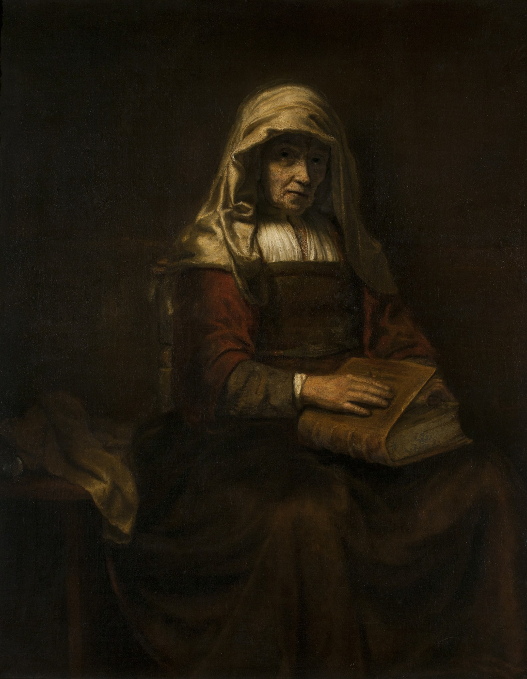 Abraham van Dyck. An old woman with a Bible on her knees