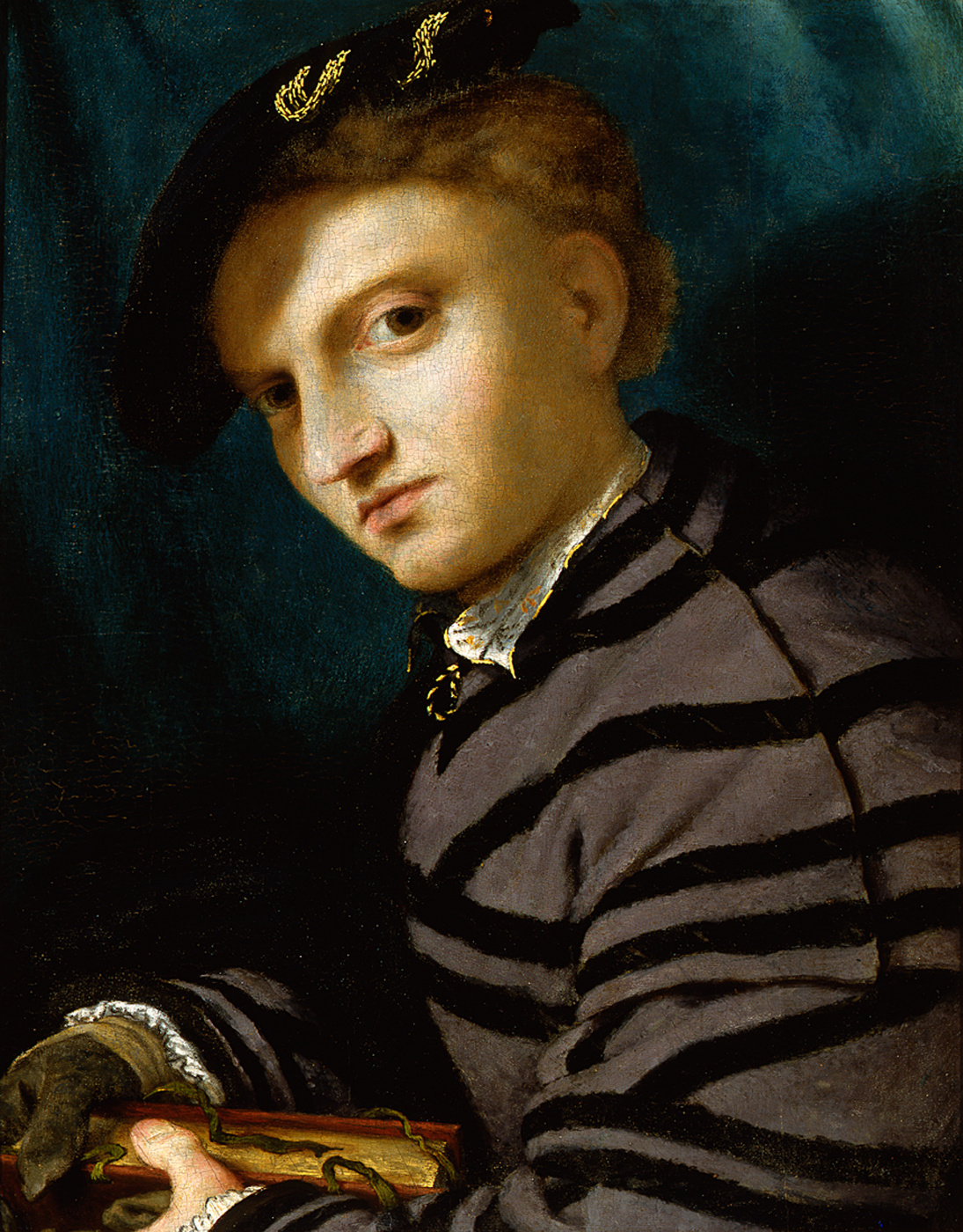 Lorenzo Lotto. Portrait of a Young Man with a Book