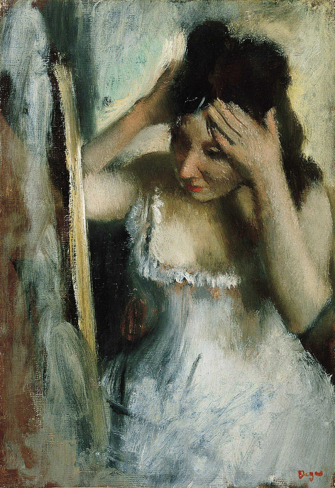 Edgar Degas. Woman combing hair in front of the mirror