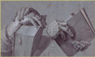 Две пары рук держат книгу