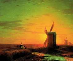 Windmills in the Ukrainian steppe at sunset
