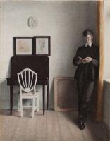 Вильгельм Хаммерсхёй. Интерьер с читающим молодым человеком