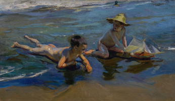 Дети играющие на пляже