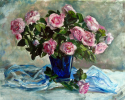 Tea roses in a blue vase