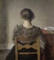 Вильгельм Хаммерсхёй. Отдых. Молодая женщина, сидящая спиной